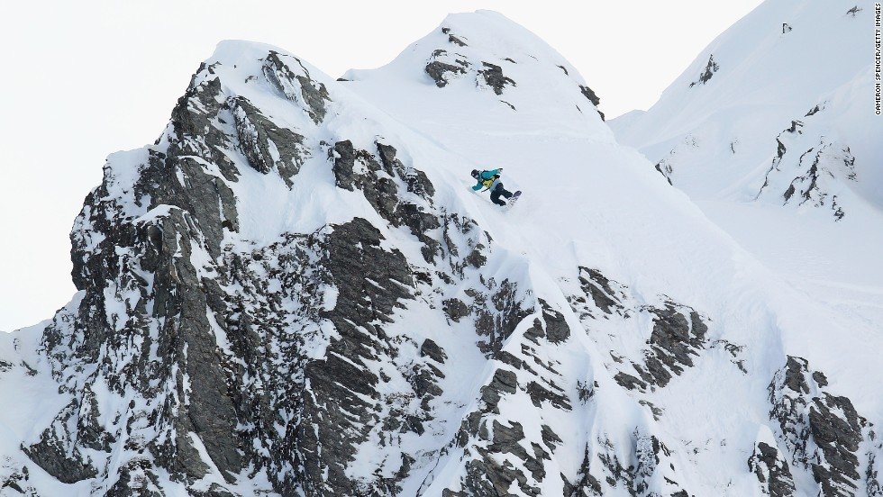 Roland Morely-Brown rides down a ridge during the 2011 World Heli Challenge at Wanaka's Mount Albert. In heli-skiing, skiers and snowboarders travel by helicopter to areas not accessible by other means.