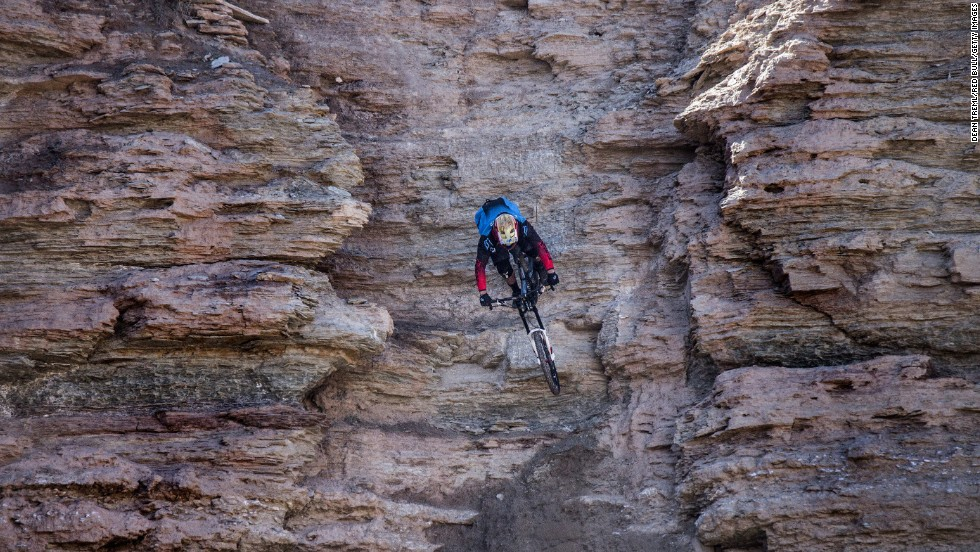 Freerider Kyle Strait competes in the 2014 Red Bull Rampage near Zion National Park in Virgin, Utah. Freeride mountain biking usually involves large drops, jumps and stunts.