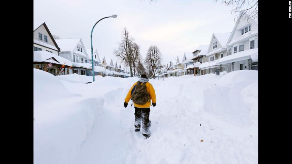 A man walks in his Buffalo neighborhood on Thursday, November 20.