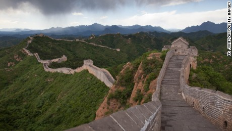 Rain clouds pass over a section of the Great Wall at Jinshanling, Hebei Province on June 10, 2012. The wall which is a series of fortifications made of stone, brick and rammed earth was subject to a recent archaeological survey that found its total length to be 21,196 km or 13,171 miles.