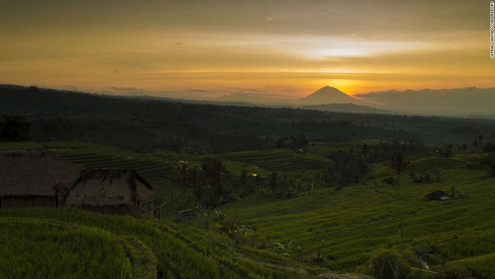 "The morning sun warms the <a href=""http://whc.unesco.org/en/list/1194"" target=""_blank"">Jatiluwih Rice Terrace</a> in Bali, <a href=""http://ireport.cnn.com/docs/DOC-1170784"">Indonesia</a>. Mount Agung, the highest point on the island, rests in the background."