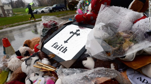 A man walks past a makeshift memorial on November 23, 2014 in Ferguson, Missouri, where a white Ferguson police officer who shot and killed 18-year-old black teenager Michael Brown. Brown's killing inflamed racial tensions in mostly black St Louis suburb of 21,000 with an overwhelmingly white police force and town government. Rising tensions in the predominantly African American community have seen US President Barack Obama call for calm, Missouri's governor declare a state of emergency and the FBI deploy an extra 100 personnel. AFP PHOTO/Jewel Samad (Photo credit should read JEWEL SAMAD/AFP/Getty Images)