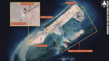 Airbus Defence and Space imagery dated November 14, 2014 shows land reclamation operations under way at Fiery Cross Reef. Multiple operating dredgers provide the ability to generate terrain rapidly. Operating from a harbour area, dredgers deliver sediment via a network of piping. Image courtesy Jane's Defense Weekly.