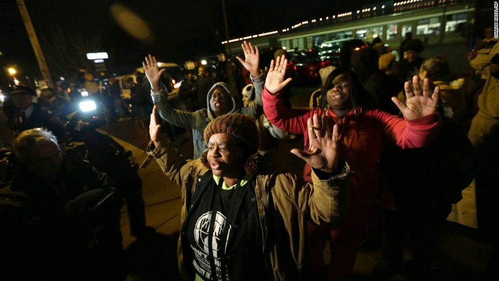 Protesters gather as they wait for the announcement of the grand jury decision on November 24.