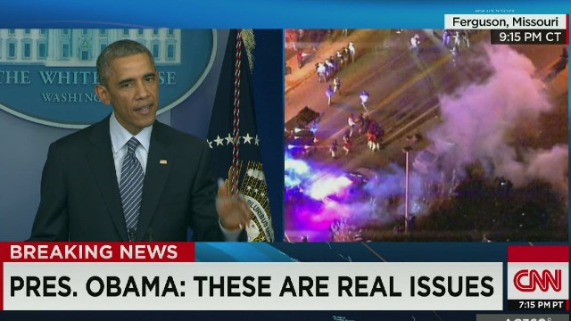 Obama speaks as smoke fills the streets