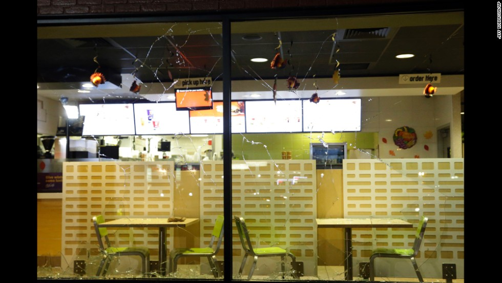 The glass windows of a store are shattered on November 24.