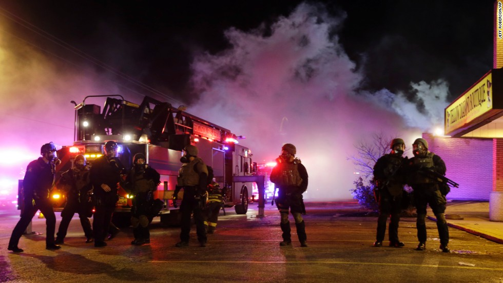 Smoke fills the streets of Ferguson as buildings burn on November 24.
