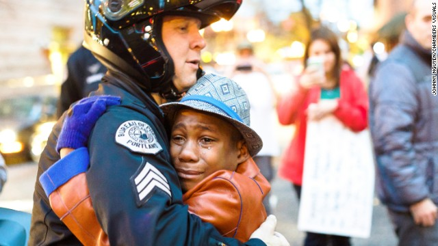 Officer in viral hugging photo speaks