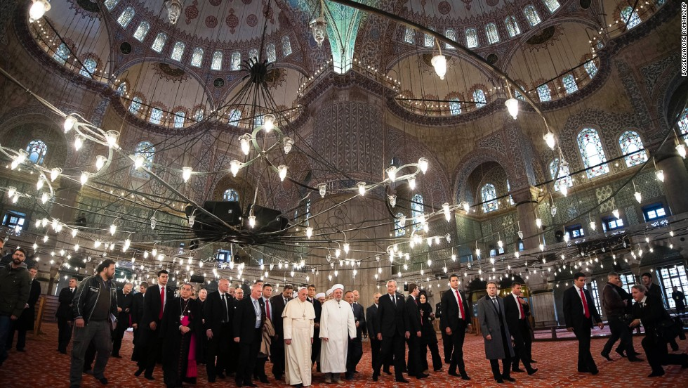 Pope Francis and Istanbul's Grand Mufti Rahmi Yaran visit the Sultan Ahmet Mosque, popularly known as the Blue Mosque, in Istanbul on November 29.