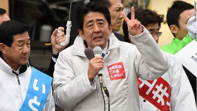 "Surrounded by candidates of the ruling Liberal Democratic Party, Japanese Prime Minister Shinzo Abe (C) gestures as he delivers a speed during hisstumping tour for the December 14 general election in Sendai, Miyagi prefecture, on December 2, 2014. Official campaigning kicked off for a snap national poll in two weeks, with Prime Minister Abe describing it as a referendum on his faltering ""Abenomics"" economic growth blitz. AFP PHOTO/Toru YAMANAKATORU YAMANAKA/AFP/Getty Images"