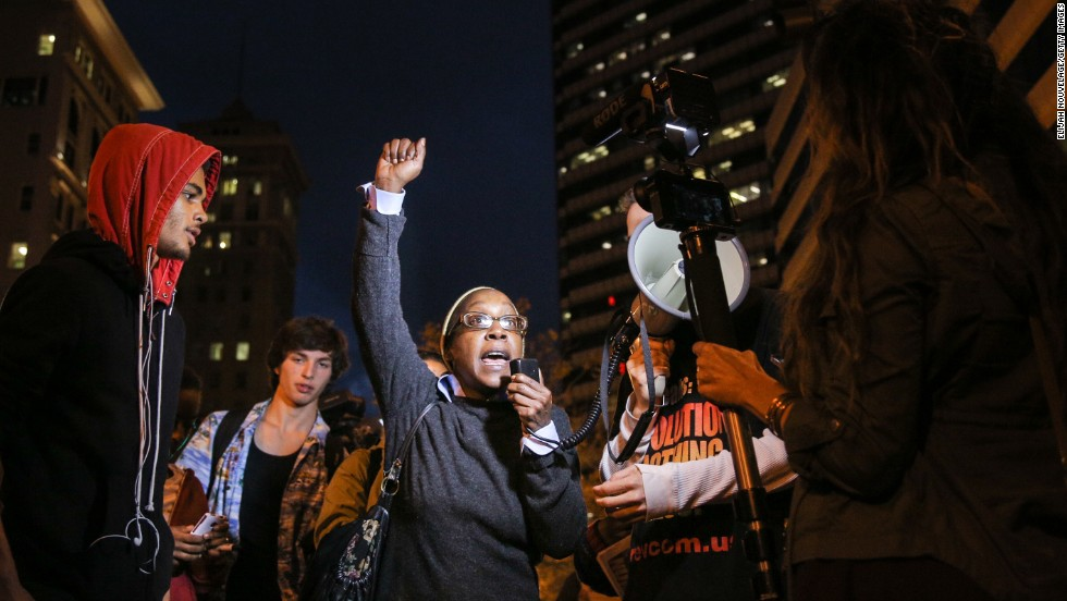 A woman speaks during a demonstration in Oakland on December 3.