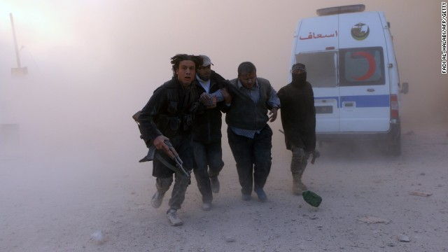 Caption:Fighters from the al-Qaida group in the Levant, Al-Nusra Front, help a wounded man following a reported barrel bomb attack by government forces in the Al-Muasalat area in the northern Syrian city of Aleppo on November 6, 2014. Syria has asked Russia to speed up delivery of S-300 anti-aircraft missiles, concerned about a possible US attack, Syrian Foreign Minister Walid Muallem said in an interview published Thursday. AFP PHOTO/AMC/FADI AL-HALABI (Photo credit should read Fadi al-Halabi/AFP/Getty Images)