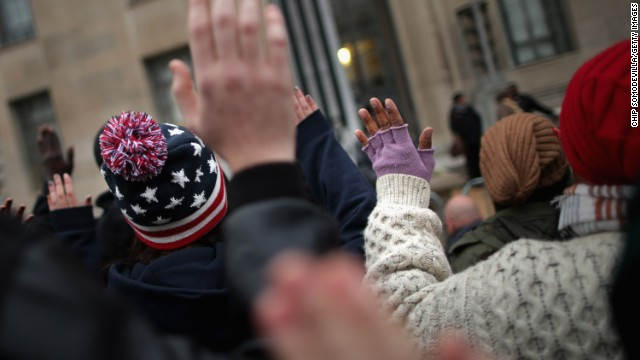 WASHINGTON, DC - DECEMBER 04: Demonstrators march in front of the Justice Department headquarters chanting 'Hands up! Don't shoot!' and 'I can't breath!' in protest against recent decisions by grand juries in the Michael Brown and Eric Garner cases, December 4, 2014 in Washington,DC. On Wednesday, a grand jury declined to bring charges against a white New York City Police Officer in the chokehold death of Eric Gardner, sparking further unrest in the wake of a grand jury's decision not to indict former Ferguson, Missouri Police Officer Darren Wilson in the shooting death of Michael Brown. (Photo by Chip Somodevilla/Getty Images)