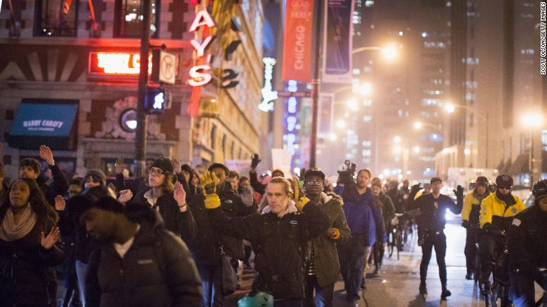 Demonstrators march through the Loop on December 5, 2014 in Chicago, Illinois.