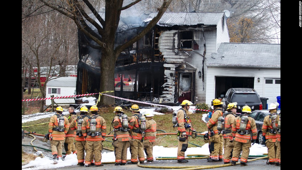 Six killed after plane crashes into home