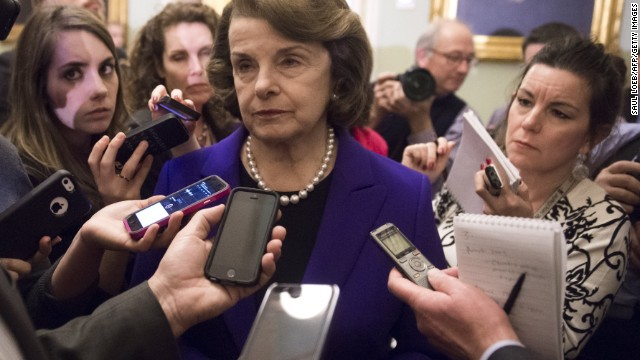 Senate Intelligence Chairwoman Dianne Feinstein (C), a Democrat from California, speaks to reporters about the committee's report on CIA interrogations at the US Capitol in Washington, DC, December 9, 2014. The CIA's interrogation of Al-Qaeda suspects was far more brutal than acknowledged and did not produce useful intelligence, a damning and long-delayed US Senate report said Tuesday. The Central Intelligence Agency also misled the White House and Congress with inaccurate claims about the program's usefulness in thwarting attacks, the Senate Intelligence Committee said. AFP PHOTO / SAUL LOEB (Photo credit should read SAUL LOEB/AFP/Getty Images)