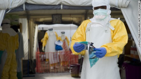 A health worker wearing a personal protective equipment (PPE) works at the Ebola treatment center run by the French red cross society in Macenta in Guinea on November 20, 2014.