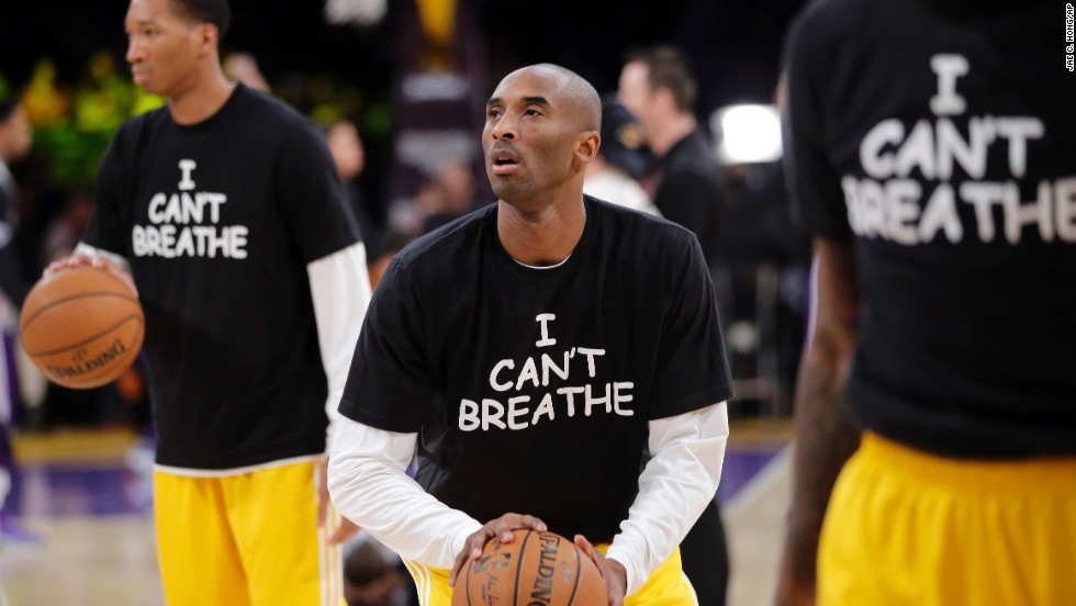 "Los Angeles Lakers' Kobe Bryant, center, warms up before an NBA basketball game against the Sacramento Kings on Tuesday, December 9, in Los Angeles. The team wore ""I Can't Breathe"" shirts during warm-ups in support of the family of Eric Garner. Since a grand jury declined to indict a New York police officer in the death of Garner, demonstrators across the country have taken to the streets to express their outrage. Garner, a 43-year-old asthmatic, died in July after he was put in a chokehold by the officer, Daniel Pantaleo."