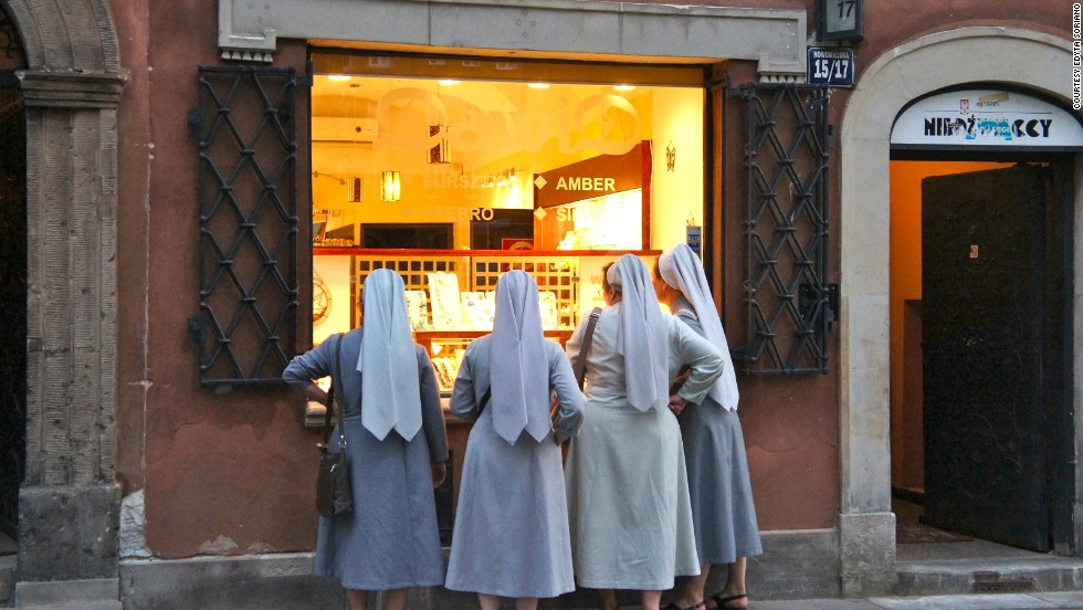 """<a href=""""http://ireport.cnn.com/docs/DOC-1184017"""">Edyta Soriano</a> captured a candid moment in her photo of four nuns peering into the window of a jewelry shop near Plac Zamkowy in Warsaw, Poland."""