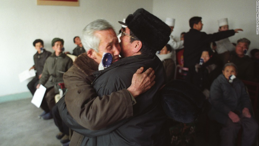 Han Mong Guk, 80, embraces his son as he sees him for the first time in 10 years after eye surgery in North Korea in 2005.