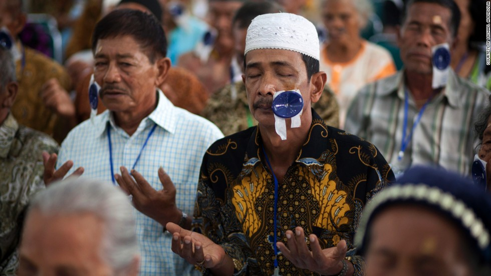 A recovering patient prays during a post operative examination session in Medan, Indonesia in 2011.