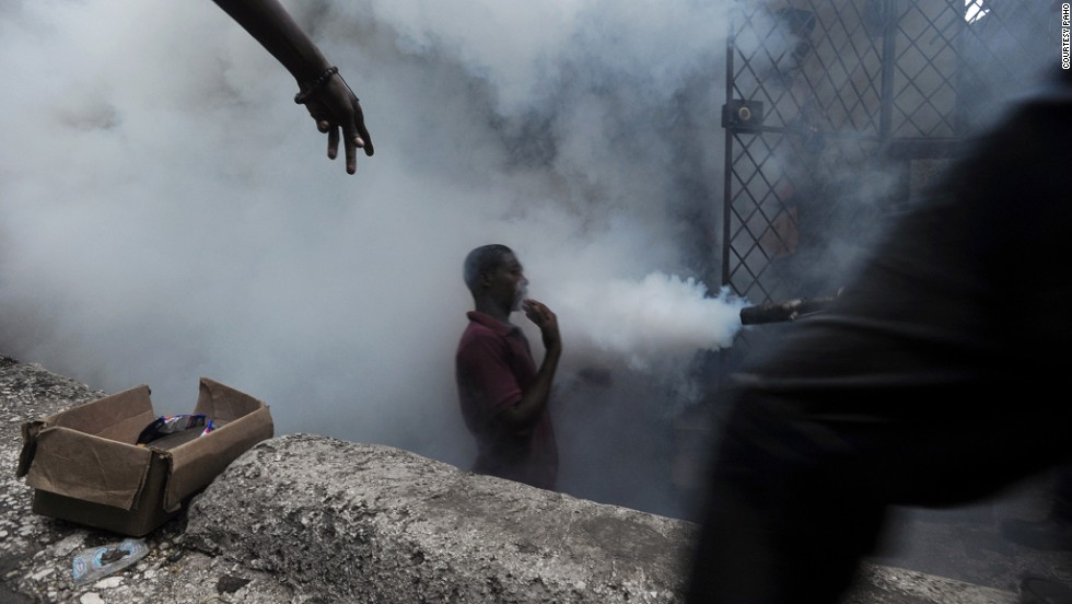 Workers from Haiti's Ministry of Public Health and Population spray chemicals to exterminate mosquitoes. Mosquito control is the main strategy used to prevent further spread of disease.
