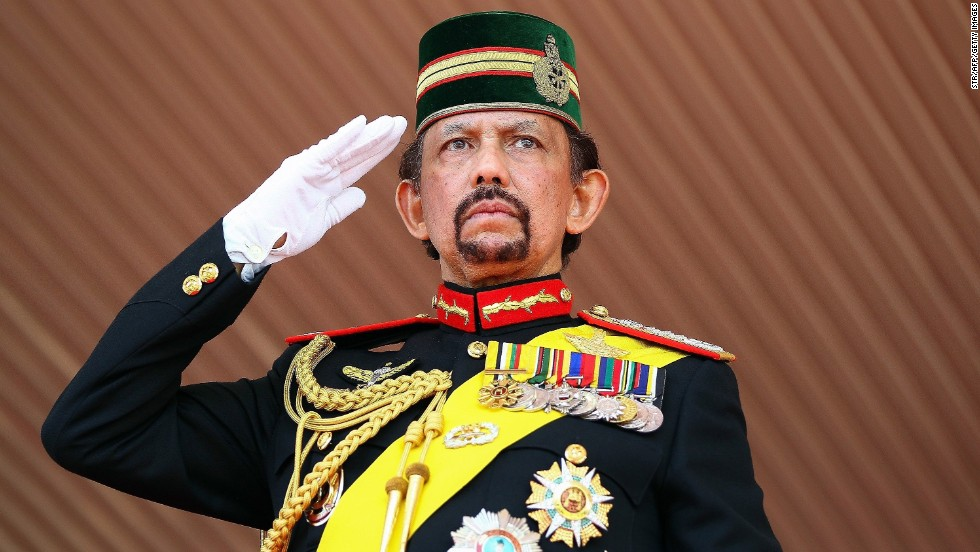 Brunei's Sultan Hassanal Bolkiah, one of the world's longest-reigning monarchs, salutes during a ceremonial guard of honor to mark his 68th birthday celebrations in Bandar Seri Begawan on August 14, 2014.
