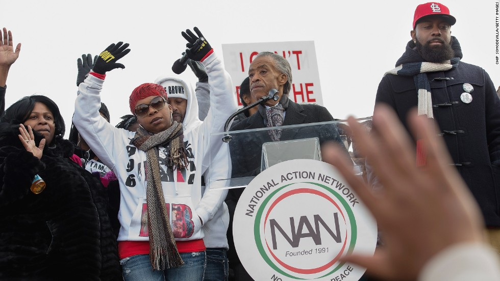 "From left, Samaira Rice, the mother of Tamir Rice; Lesley McSpadden, the mother of Michael Brown Jr.; the Rev. Al Sharpton and Michael Brown Sr., the father of Michael Brown Jr, raise their hands in the air during the ""Justice For All"" march and rally through Washington on December 13."