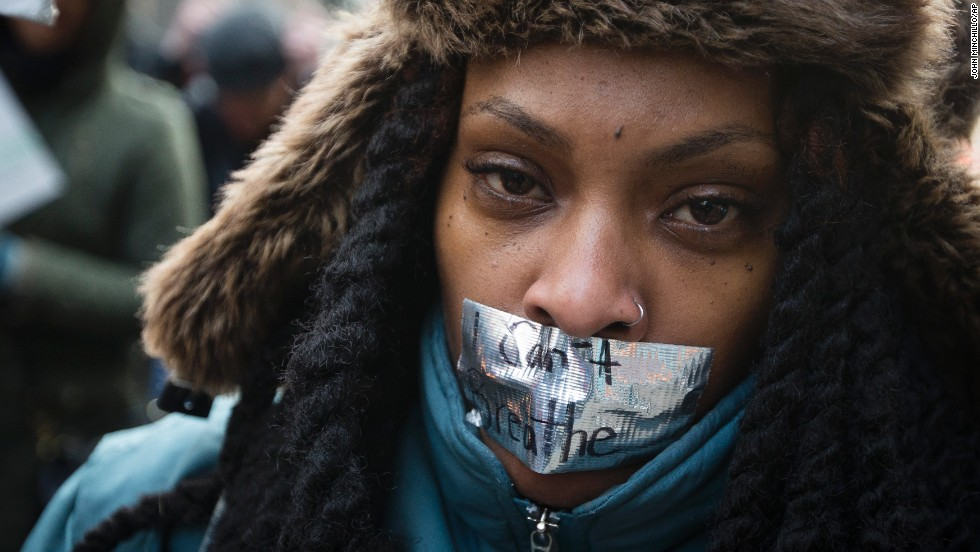 "A demonstrator marches in New York on December 13 during the ""Justice for All"" rally."