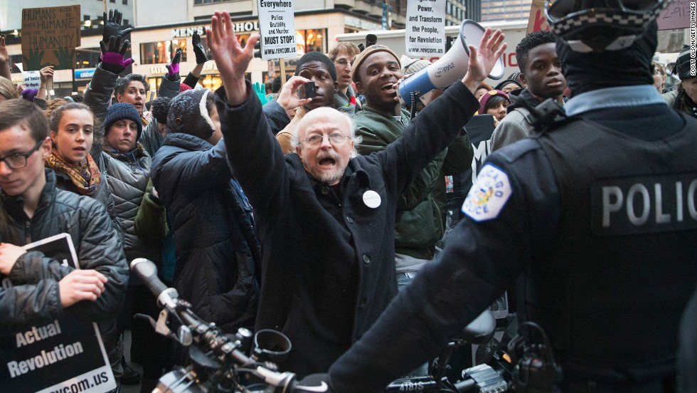 Demonstrators face off with police during a march in Chicago on December 13.