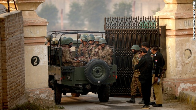 Pakistani army soldiers in a vehicle arrive at the gates of a school in Peshawar on December 17, 2014, the day after an attack on the army school in the northern city. Pakistan has begun three days of mourning for the 132 schoolchildren and nine staff killed by the Taliban in the country's deadliest ever terror attack as the world united in a chorus of revulsion. The 141 people were killed when insurgents stormed an army-run school in the northwestern city of Peshawar on Tuesday and systematically went from room to room shooting children during an eight-hour killing spree. AFP PHOTO / Farooq NAEEM (Photo credit should read FAROOQ NAEEM/AFP/Getty Images)
