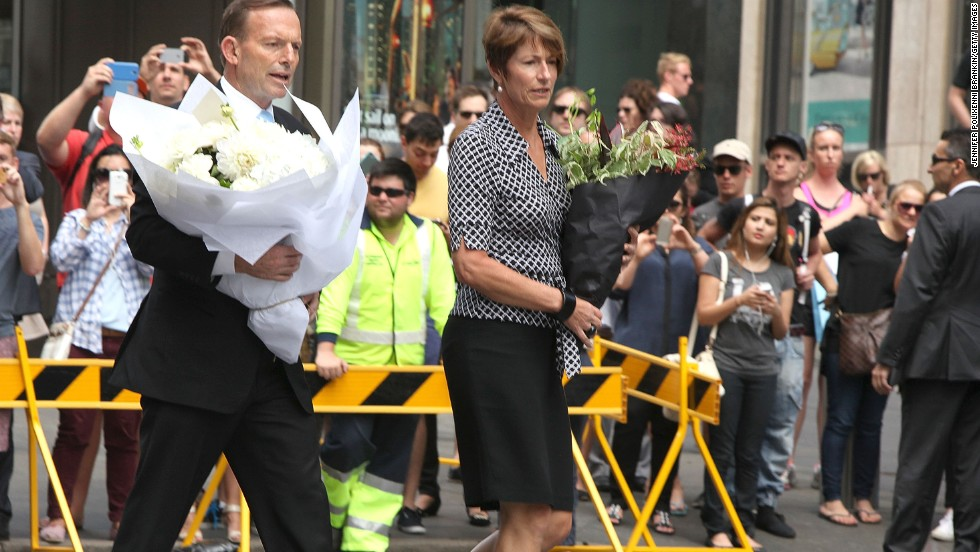 Prime Minister Tony Abbott arrives with his wife Margaret to pay their respects at Martin Place on December 16.