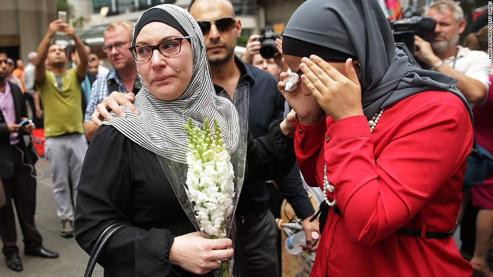 Members of the Muslim community show their respect at Martin Place on December 16.