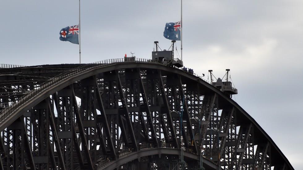 Australian flags fly at half mast on Sydney Harbour Bridge on December 16 following the fatal siege.