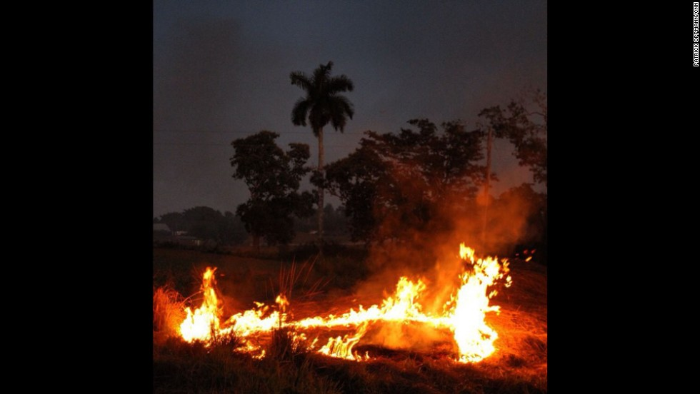 """Oppmann notes a """"(b)rush fire by side of the road on the drive from Pinar del Rio to Havana."""""""