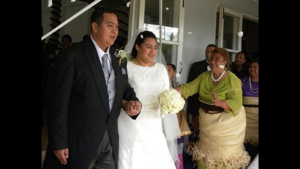 In the Pacific Island nation of Tonga, Crown Prince Tupouto'a 'Ulukalala, left, and his bride, Sinaitakala Tu'imatamoana 'i Fanakavakilangi Fakafanua, leave church after a wedding ceremony in Nuku'alofa on July 12, 2012.