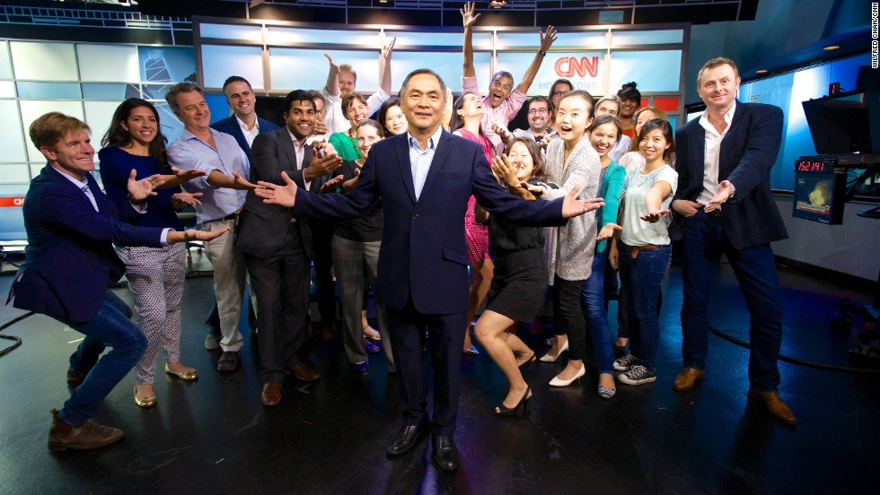 Jaime FlorCruz with friends and co-workers in CNN's Hong Kong newsroom on announcing his retirement.