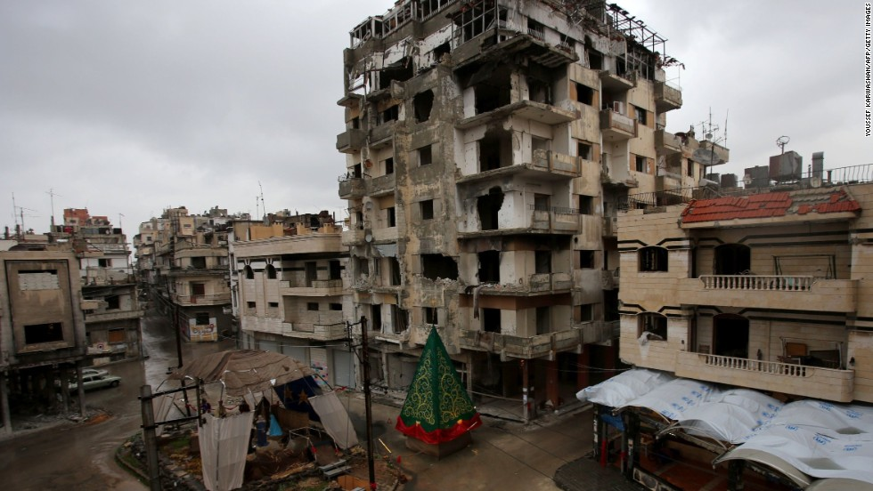 A Christmas tree and a crèche made out of rubble are set up on a square in the, predominantly Christian, government-held Hamidiyeh neighborhood of Homs on Monday, December 22.