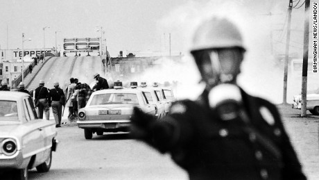 Image #: 1967854    March 7, 1965, Selma: Using batons and tear gas, Alabama state troopers break up the march from Selma to Montgomery at the Edmund Pettus Bridge. The clash became known as ìBloody Sunday.î      Birmingham News/Landov