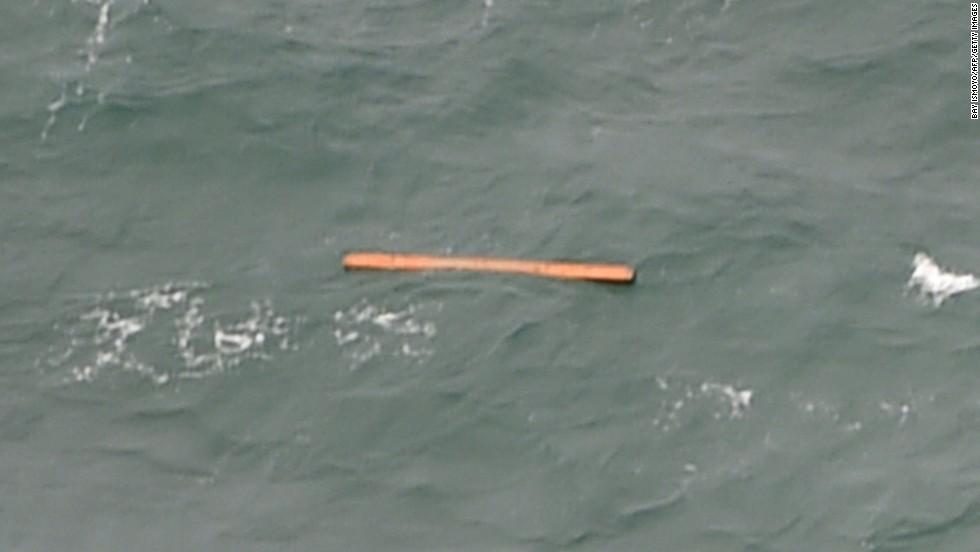 Debris floats in the Java Sea on December 30.