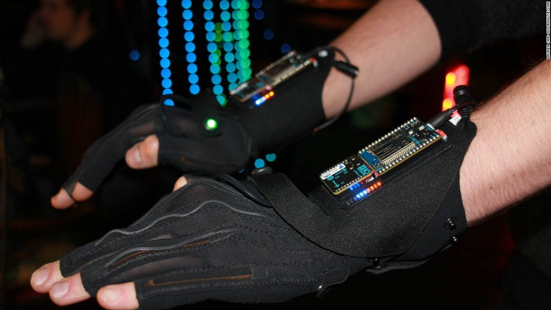 The music-manipulating gloves, as demonstrated by a Mi.Mu team member, are the latest attempt by Grammy Award-winning musician Imogen Heap to bring technology and music together in visually stimulating harmony.