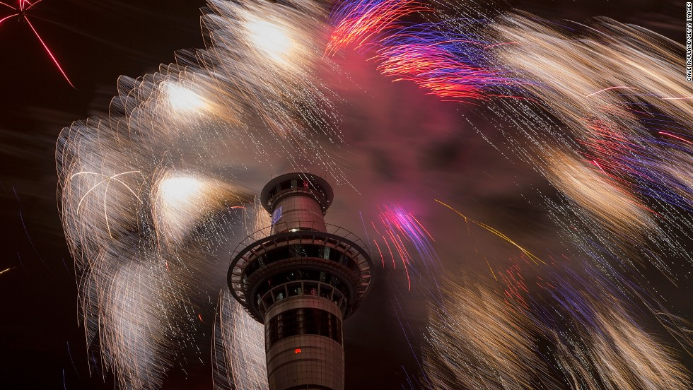 A fireworks display at the top of the Sky Tower welcomes the new year in Auckland, New Zealand.