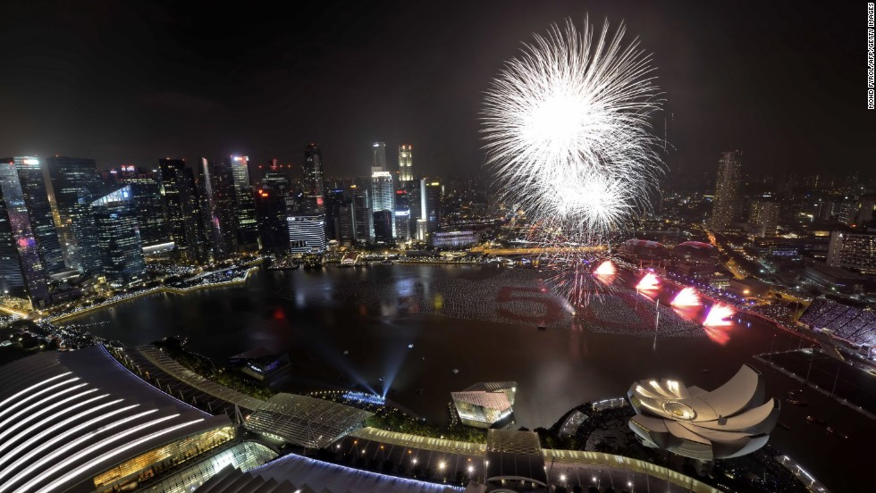 Fireworks burst over Marina Bay in Singapore.