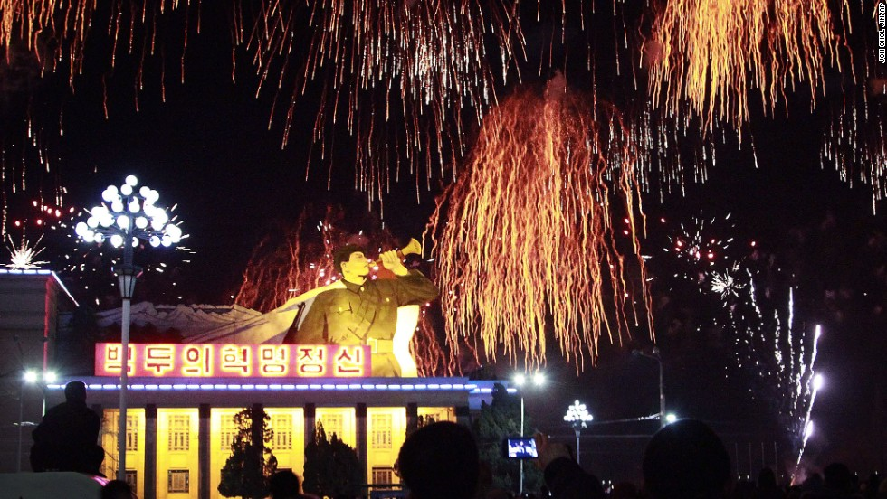People gather at the Kim Il Sung Square to watch a fireworks display in Pyongyang, North Korea.