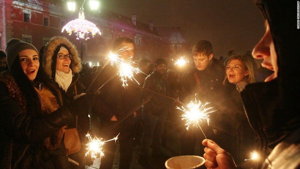People gather to celebrate the arrival of the new year at Castle Square in Warsaw, Poland.