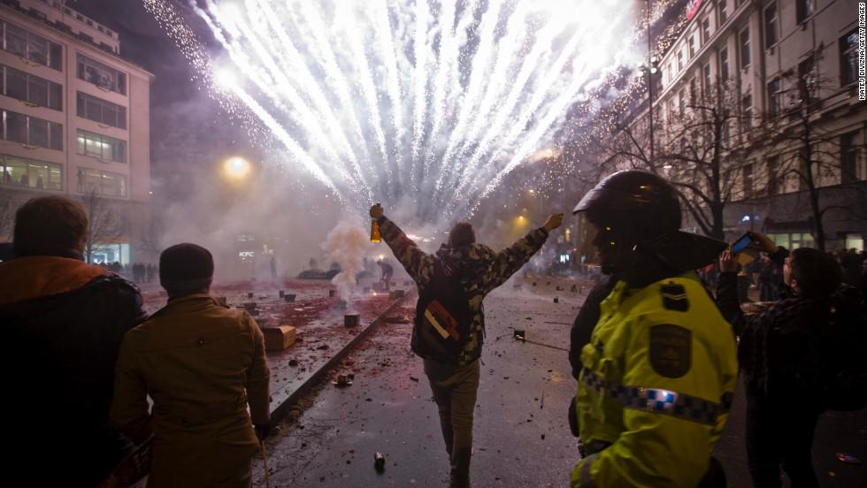 Fireworks explode in Wenceslas Square in Prague, Czech Republic.