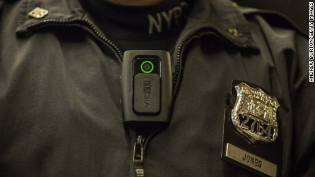New York Police Department (NYPD) Officer Joshua Jones demonstrates how to use and operate a body camera during a press conference on December 3, 2014 in New York City.  (Photo by Andrew Burton/Getty Images)