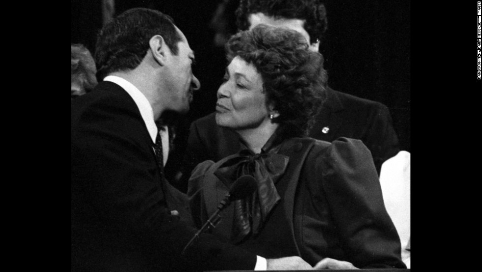 Cuomo kisses his wife, Matilda, during his inauguration as New York governor in 1983.