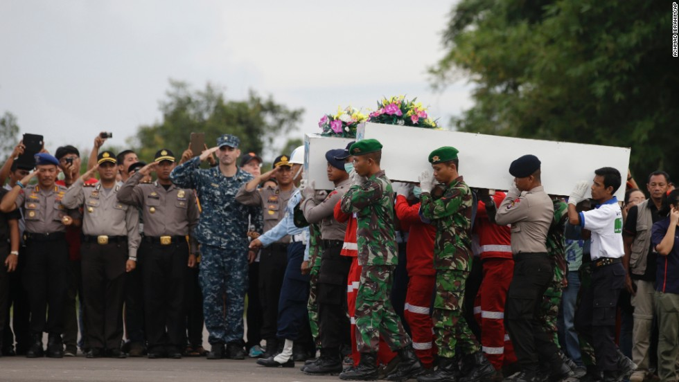 Members of the National Search and Rescue Agency and Indonesian soldiers carry coffins containing bodies of victims in Pangkalan Bun on January 2.
