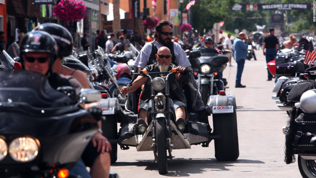 Bikers roar down Main Street during the annual Sturgis Motorcycle Rally.